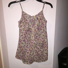 Free People Floral top Worn twice. Perfect condition. Only flaw is that the metal tag is starting to come off. This is a gorgeous top! Free People Tops Blouses
