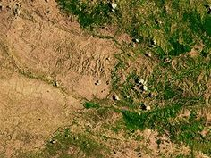 Haiti's border with the Dominican Republic (right) shows the amount of deforestation on the Haitian side