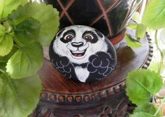 Baby Panda, painted rock.