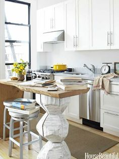 The unusual kitchen island is made from fallen oak and a hand-carved cherry log painted white. Design: Fitzhugh Karol and Lyndsay Caleo