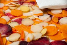 Dehydrated vegetable chips make a delicious and healthful snack. And they are easy to prepare too. Gather your favorite root vegetables such as carrots, potatoes, sweet potatoes or parsnips, slice them thinly and then blanch the slices to preserve the flavors and nutrients. A food dehydrator will dehydrate the vegetable slices within approximately six hours …