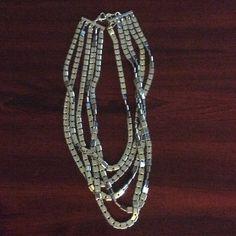 JL multi strand silver necklace Nice necklace, can be dressy or not. Jennifer Lopez Jewelry Necklaces