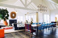 The 11 Greatest Lessons We Learned From Jonathan Adler // dining room, living room, open plan, blue dining chairs, chrome light fixture