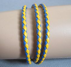 Shoply.com -Woven leather cord bracelet Fashion yellow blue color. Only $3.50