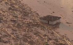 05/11 - Casa soterrada pela enxurrada em distrito de Mariana