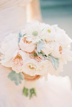 Brides.com: 20 Fresh Peony Bouquet Ideas. A modern peach bouquet is a go-to choice for spring and summer brides. This one combines peonies, garden roses, ranunculus and dusty miller.