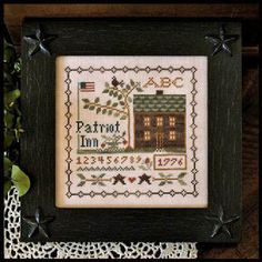 Little House Needleworks Patriot Inn - Cross Stitch Pattern. Model stitched on 32 Ct. Vintage Light Examplar from Lakeside Linens with DMC floss and Crescent Co