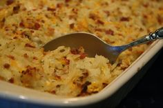 Crack Potatoes-- Like a twice baked, only it's a casserole. Sour cream, ranch seasoning, cheddar, bacon, and frozen hash browns.