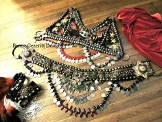 Uniting Ages Complete Tribal Fusion Bellydance Costume bra belt headdress skirt and cowl. $750.00, via Etsy.