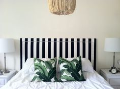 Banana leaf pillows from Stuck on Hue pop off a graphic black and white headboar. Decor, Apartment Room, Banana Leaf Pillow, Home Decor Bedroom, Leaves Pillow, Palm Pillow, White Headboard, Home Decor, Tropical Bedrooms