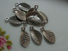 Oxidized Sterling Silver Tiny Leaf Stamping Pendant by TerraFinds