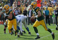 Aaron Rodgers Photos Photos - Aaron Rodgers #12 of the Green Bay Packers runs for a first down in the fourth quarter against the Detroit Lions at Lambeau Field on September 25, 2016 in Green Bay, Wisconsin. The Packers defeated the Lions 34-27. - Detroit Lions v Green Bay Packers