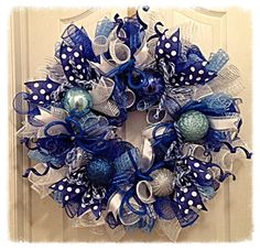 This beautiful Blue and Silver Christmas Wreath is sure to brighten your home or covered front porch this Christmas season.    It is made with