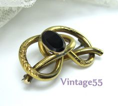 Victorian Knot Brooch Black glass gold by Vintage55 on Etsy, $52.00
