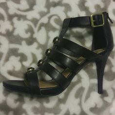 NEW Fergalicious gorgeous black heels 4 inch heel with zipper in the back. Size 8. Very sexy. Brand new Fergalicious Shoes Heels