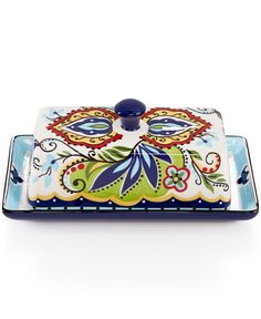 Bright colors in Spanish tile-inspired designs make this lidded butter dish from Espana an eye-catching addition to your table or counter top. Hand crafted and made of durable earthenware, this butter