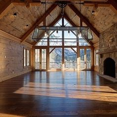 """I love how this is natural wood without the """"log cabin"""" feel. I also love how the entire house is focused on that view! Windows - wow!!"""