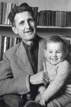 Author George Orwell with his two-year-old adopted son Richard Blair. Taken in November 1946 at his flat at 22b Canonbury Square, Islington, London.