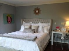 Jillian Barberie styles her modern and chic bedroom with Z Gallerie's Jameson Bed and faux Chinchilla Throw & Pillow.