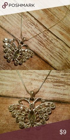 Crystal Butterfly Necklace This beautiful butterfly necklace hangs from a silvertone chain w/lobster closer and has its body and wings encrusted with beautiful clear c.z. crystals Jewelry Necklaces