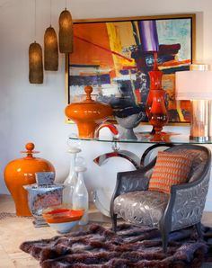 From Gucci to Diane von Furstenberg, designers everywhere are clamoring after orange and purple color blocking and it works just as well for creative interiors!
