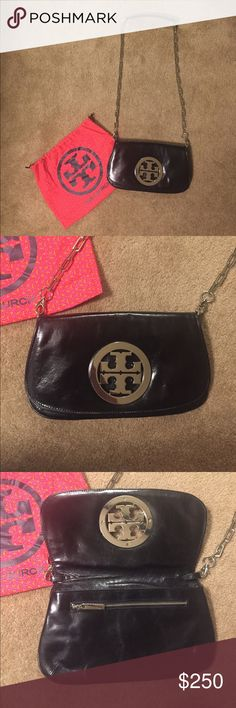 🔴LAST CALL🔴Tory Burch Black Patent Crossbody Beautiful patent leather with silver chain. Comes with dustbag. Inside of purse is spotless and attached mirror still has protective covering and zip-tie attached. Only worn 3 times. The chain can be wrapped inside in order to convert the purse into a clutch. Silver logo on outside. Tory Burch Bags Crossbody Bags
