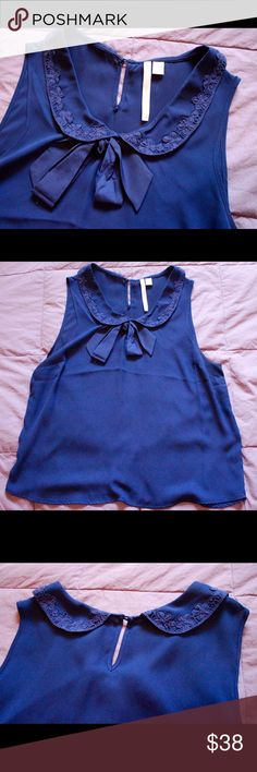 LC Lauren Conrad Navy Sweetheart Bow Tank/Blouse This blouse is super professional or dressy, and can easily be dressed down to be a classically beautiful top. I've worn this one time, so it is like new. It's flattering on all body types! Best offer! LC Lauren Conrad Tops Blouses