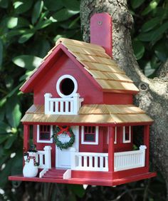 This one-of-a-kind birdhouse features a distinctive wrap-around porch with rear stairs, as well as the traditional front stoop. A gable-covered balcony adorns the front of the house. The Backyard Bird