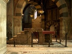 An imposing marble throne illuminated by the sun.  Aachen Cathedral, Aachen, DE.