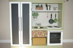 """I stumbled upon a blog called Entirely Smitten and """"liked"""" the Facebook page and found this kids kitchen made from an old tv/entertainment center on FB!  My grandkids would love this!"""