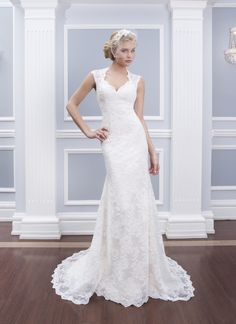 Lillian West lillian west style 6314 Two piece column gown features alencon lace overlay and charmeuse slip. Lace overlay features a Queen Anne neckline and a high shear enclosed back by satin buttons. Charmeuse slip dress features spaghetti straps and a sweep length train.