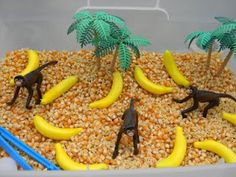 Sensory Bin Monkey Business Inside the bin: Corn kernels monkeys alphabet pasta bananas and vintage palm trees. Oh and some plastic tweezers for picking out letters and a plastic formula scoop. Sensory Tubs, Sensory Boxes, Sensory Play, Speech Therapy Activities, Sensory Activities, Toddler Activities, Preschool Jungle, Preschool Ideas, Preschool Crafts