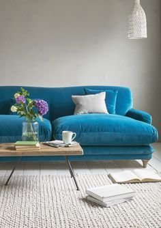 Loaf's cosy Pudding sofa in a bright blue Real Teal velvet in this cream living room with natural accessories