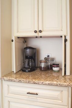 Coffee maker and supplies behind side pocketing doors