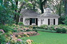 Curving Flowerbeds - 21 Gardens That Have Us Itching for Spring - Southernliving. Even though there's plenty of room for kids to play, it doesn't look like a soccer field.