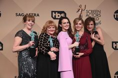 """Real life """"Downton Abbey:"""" Here are Phyllis Logan [Mrs. Hughes], Lesley Nicol [Mrs. Patmore(!)], Sophie McShera [Daisy], Joanne Froggett [Anna], and Raquel Cassidy [Baxter] after receiving the award for best ensemble cast at this weekend's SAG awards. (Photo: Frederic J. Brown/Getty Images)."""