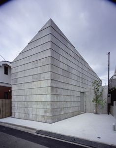 """Rainy Sunny was built by Mount Fuji Architects Studio in Tokyo in 2008. It is made of reinforced concrete to resemble """"the wrinkles of well-used jeans,"""" the architects said."""