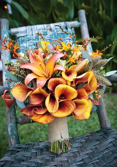 Wedding bouquet. Lilies and burlap. Not quite the right colors, but I love the multi-colored lillies!