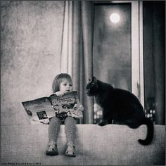 Child reading to its cat, a pure grasp of innocence  Sometimes the world feels so right Vinny and the Black Cat (Bedtime Stories)