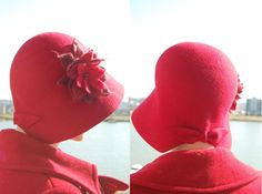Red Cloche felt hat with red felt flower. £97.00, via Etsy.