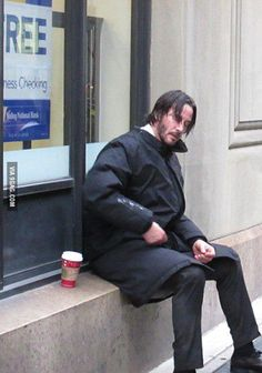 Even (pretend) contract killers need a break now and then--those guns are heavy! (chicfoo) keanu