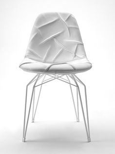 Diamond chair with rippled leather upholstery. Designed by Stolt Design Group (Norway).