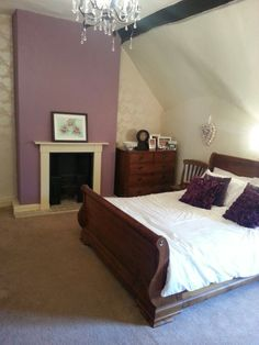 Purple bedroom looking better already now I've painted the chimney breast