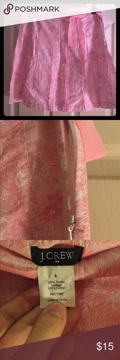J Crew pleated floral print skirt J Crew pleated floral print skirt. Side zip and pink ribbon belt runs across top and ties. Plain white lining underneath. J. Crew Skirts
