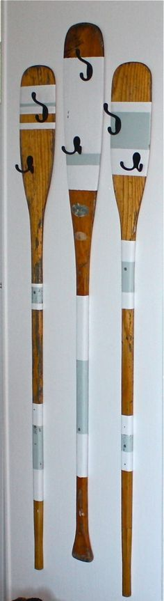 upcycled rowing oars into coat hangers - for the mudroom, lake house, man cave etc. for the iron hooks click here: http://www.priorsrec.co.uk/hat-and-coat-hook-iron/p-3-10-55-236
