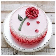 The red rose speaks of love silently, in a language known only to the heart. Valentine special flower cake.