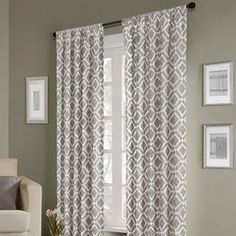 "This product must be ordered in multiples of 2.Textured cotton-twill curtain with a trellis motif.  Product: CurtainConstruction Material: 100% PolyesterColor: GreyFeatures:  Rod pocketBack tabsLined Dimensions: 84"" H x 42"" W"