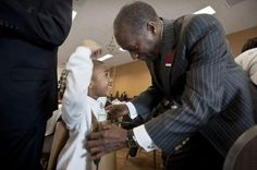Terrell Macadoo, 4, of Detroit gets a hand from Roy Roberts, Detroit Public Schools emergency financial manager, putting on the car costume he just made as 200 DPS preschoolers participate in the PNC Foundation's Grow Up Great program on Education Day at the North American International Auto Show at Cobo Center, Wednesday, Jan. 23, 2013, in Detroit. Car Costume, Education Day, Detroit Auto Show, Detroit Free Press, Public School, Schools, Growing Up, Wednesday, Preschool
