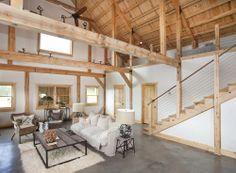 Beautifully open living space in a wood barn home!  www.sandcreekpostandbeam.com https://www.facebook.com/SandCreekPostandBeam