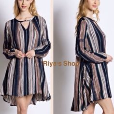 Button front smocked tunic dress Material: blend of rayon and polyester. Runs big. Has button detail on the front top. Can be worn as a tunic or as a dress. Supposed to fit loose. Available in small, medium and large. Great quality material. Pink Peplum Boutique Dresses